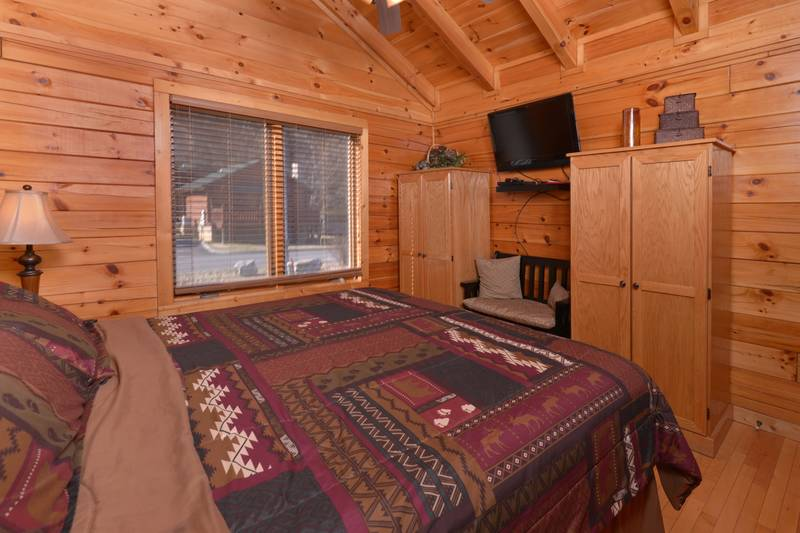 Pigeon Forge Two Bedroom Cabin Rental King Size Bed in the Master Bedroom