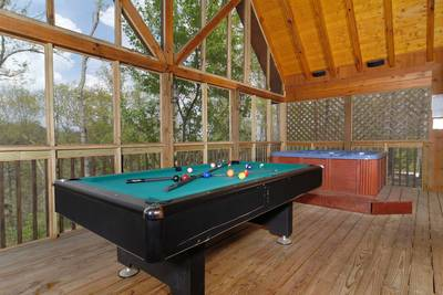 Hot Tub and Pool Table on screened in porch