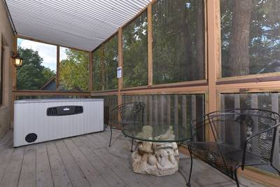 Screened in porch area with the hot tub
