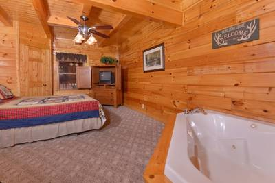 Pigeon Forge One Bedroom Cabin Rental that features a King Size Bed and Whirlpool in the Master Suite