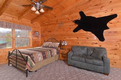 Smoky Mountain Vacation Cabin Rental featuring a seating area in the Gameroom