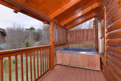 Pigeon Forge One Bedroom Plus loft Cabin Rental featuring a hot tub and outdoor pool access
