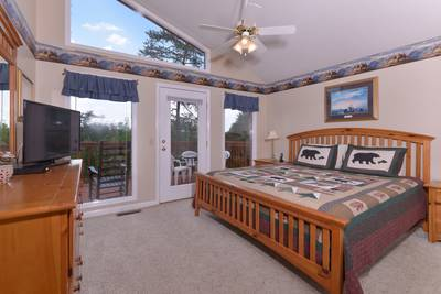 Pigeon Forge Chalet Rental Bedroom with a Flat Screen Television