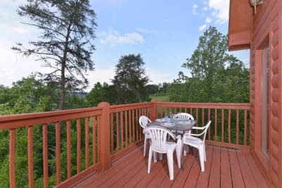 Pigeon Forge Convenient Chalet Rental with an outdoor seating area great for morning coffee